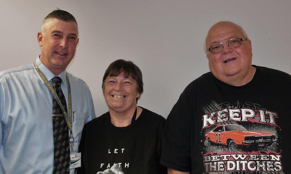 Debbie Case smiles alongside HNJH Pharmacist, Mark Fischer, and husband, Fred.