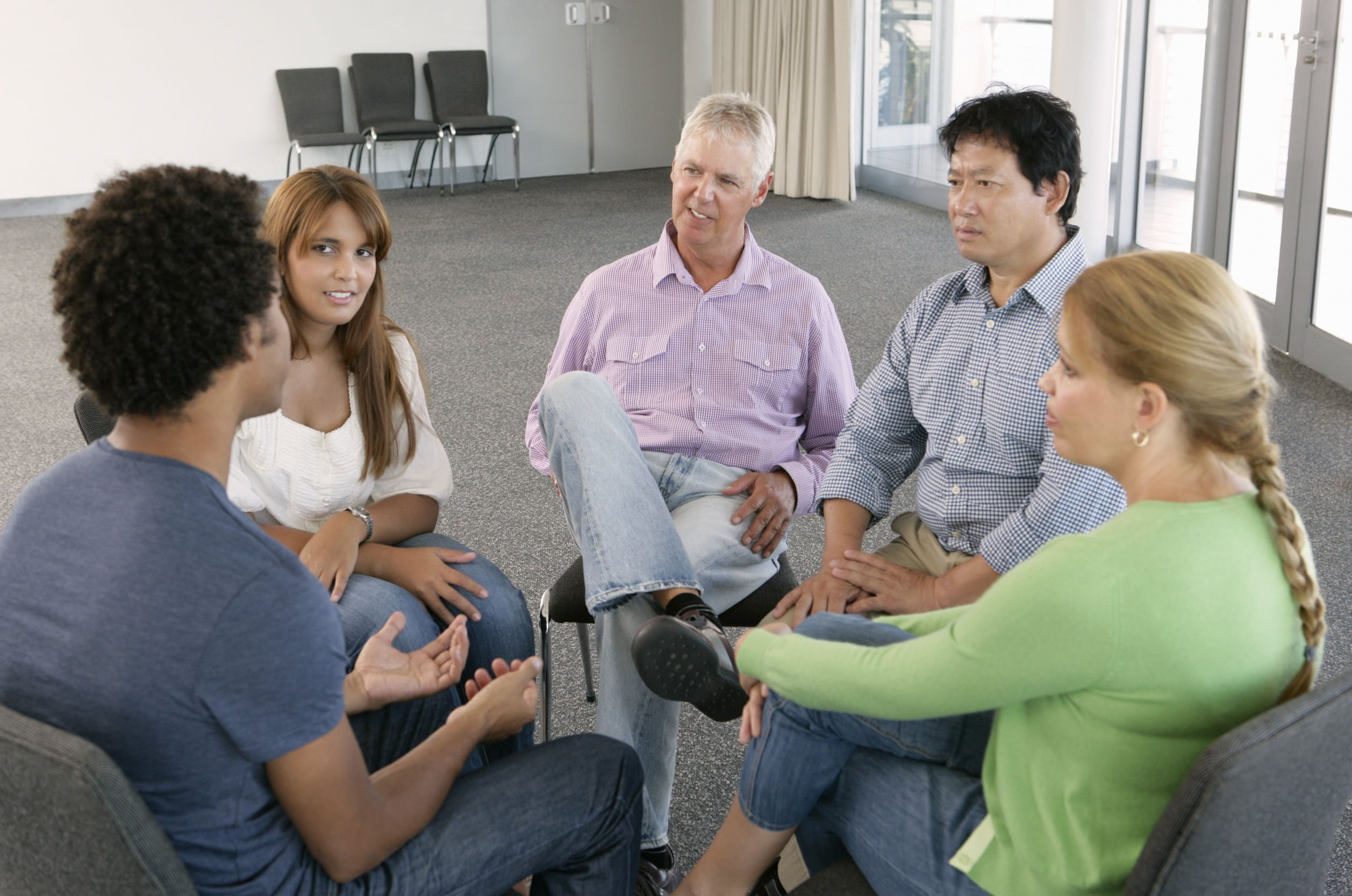 people sitting in a support group