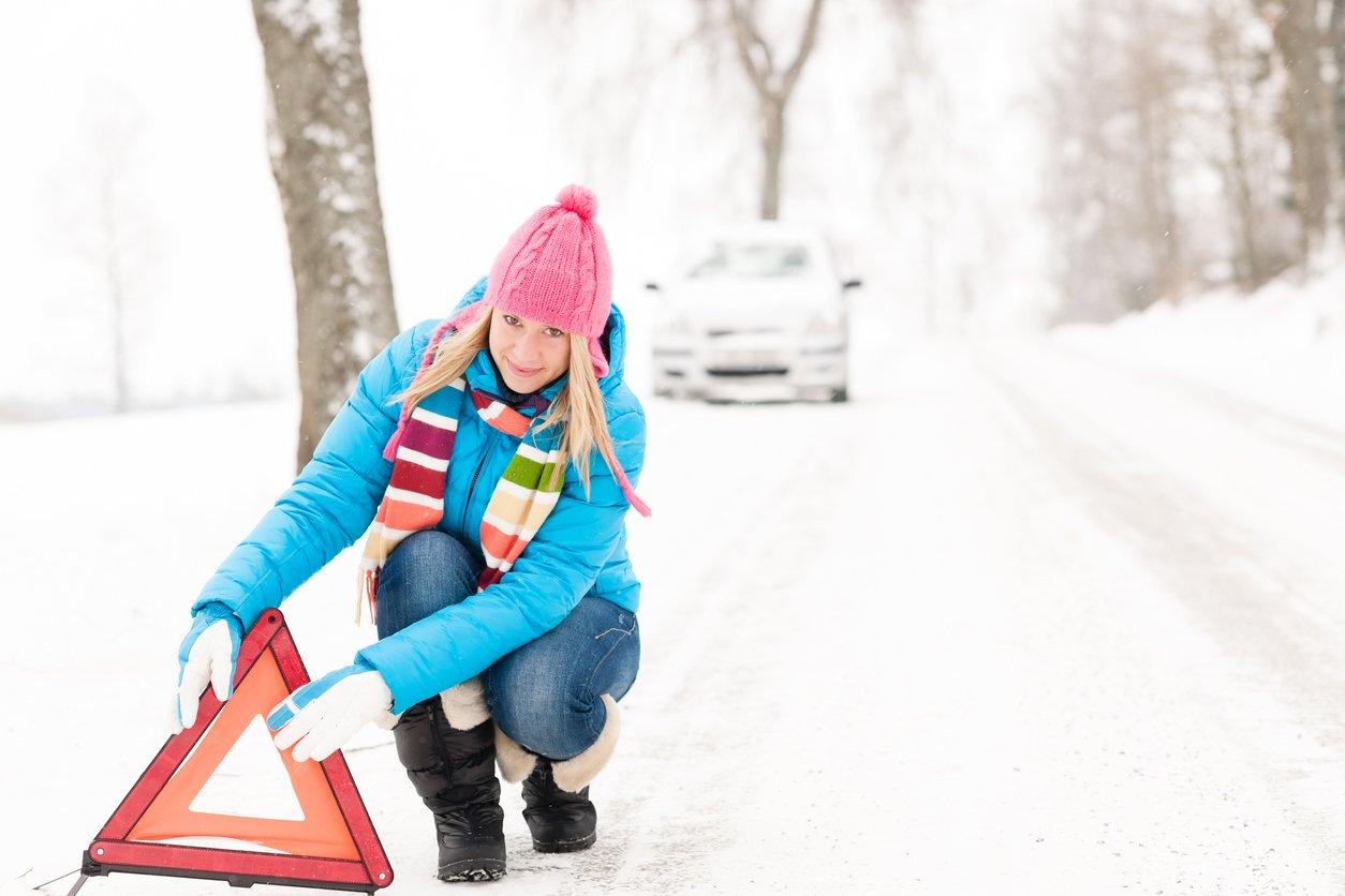winter car emergency kit - car stuck in snow