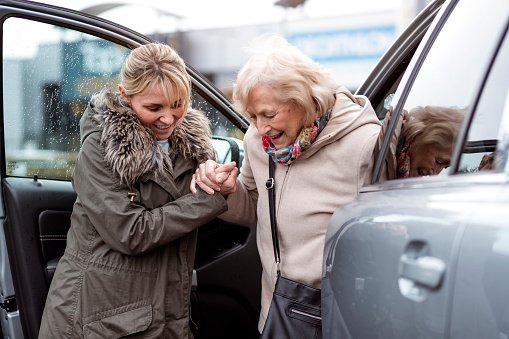 senior driver getting out of car idrivesafely.com