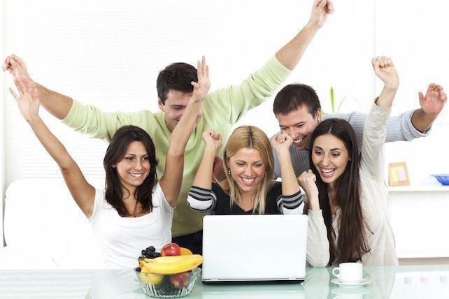 People Cheering around Laptop