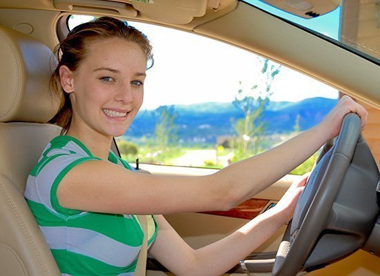 Image of a teen driver who's happy and ready for some supervised practice driving.