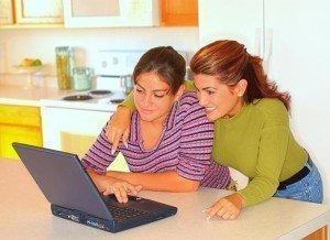 teen and mom using compuiter