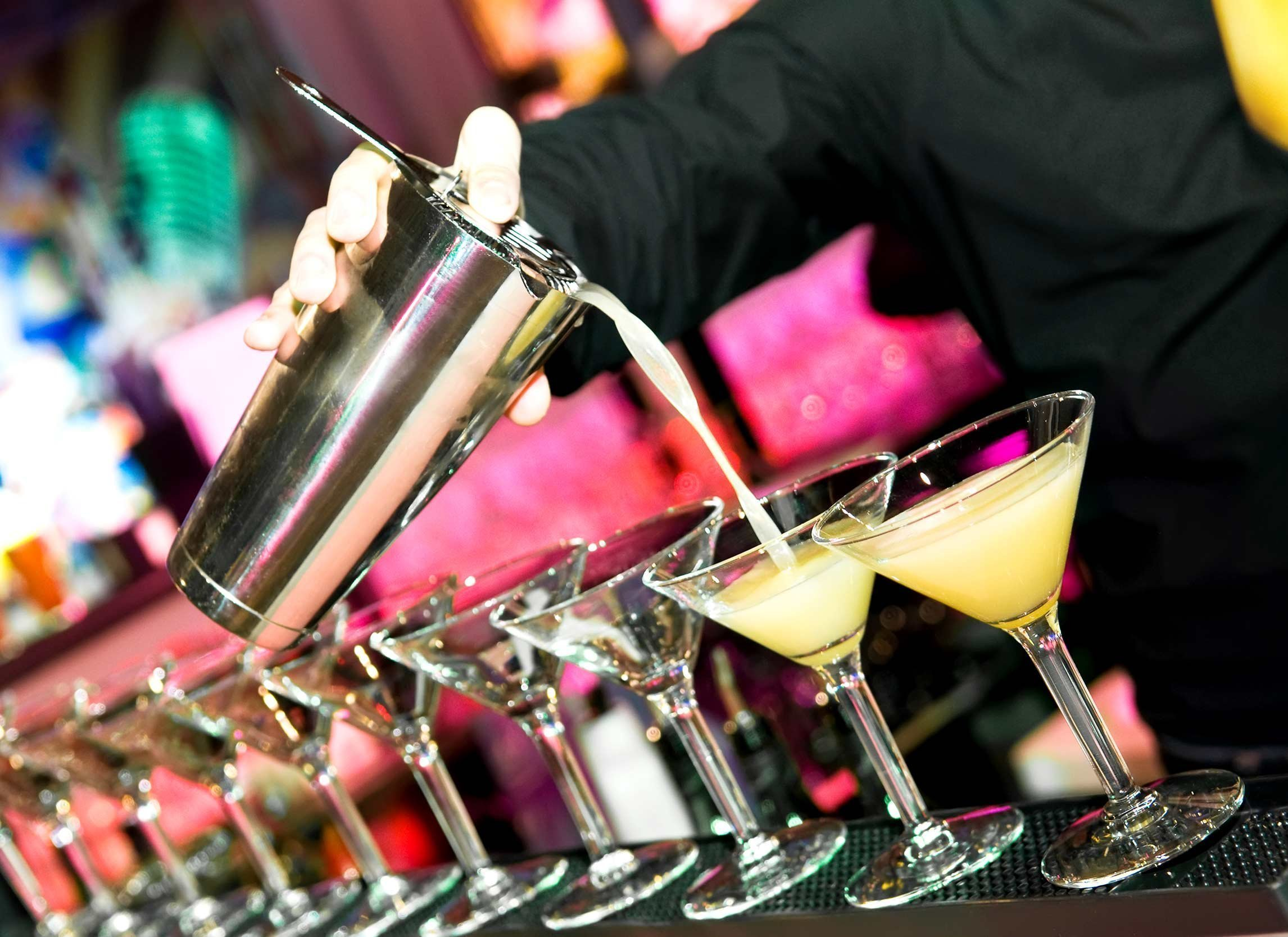 pour martinis in bar