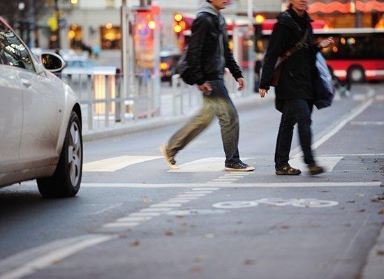 car stopped at pedestrian crosswalk