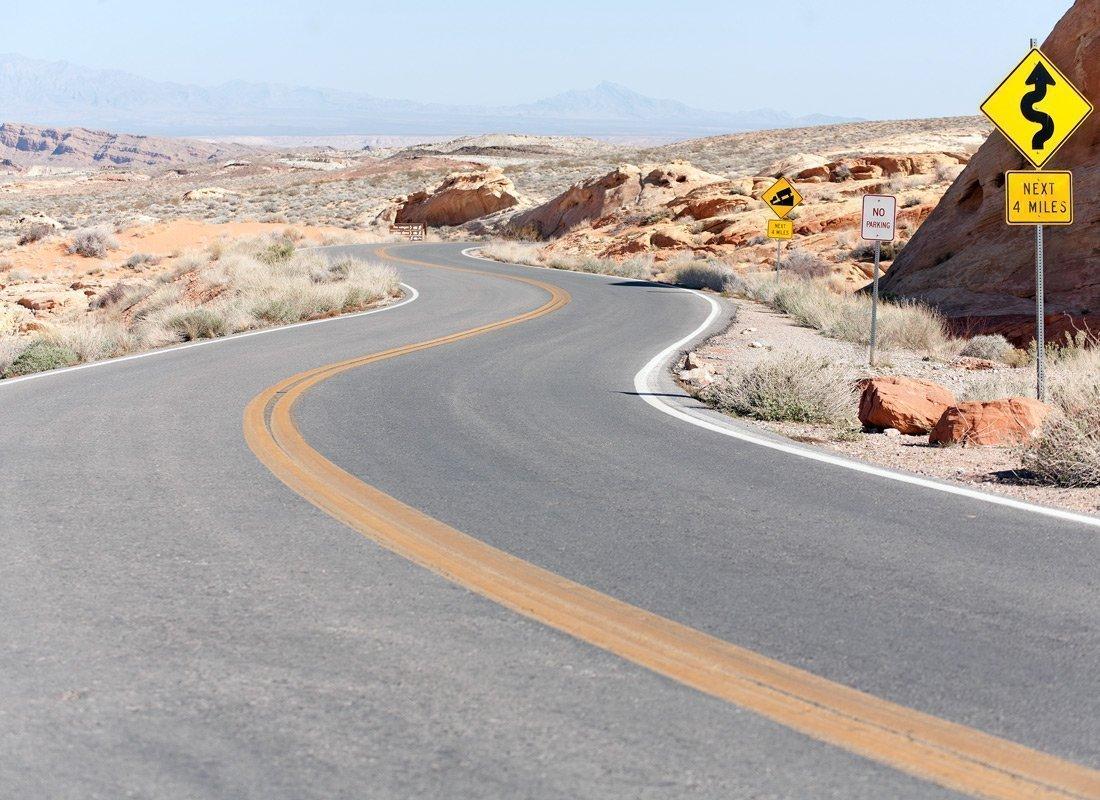 Winding Rural Road in a Desert