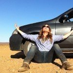 woman with car stuck in sand