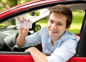 male teen driver showing license