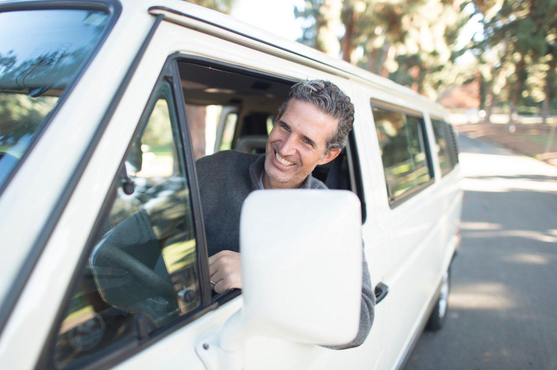 man driving white van