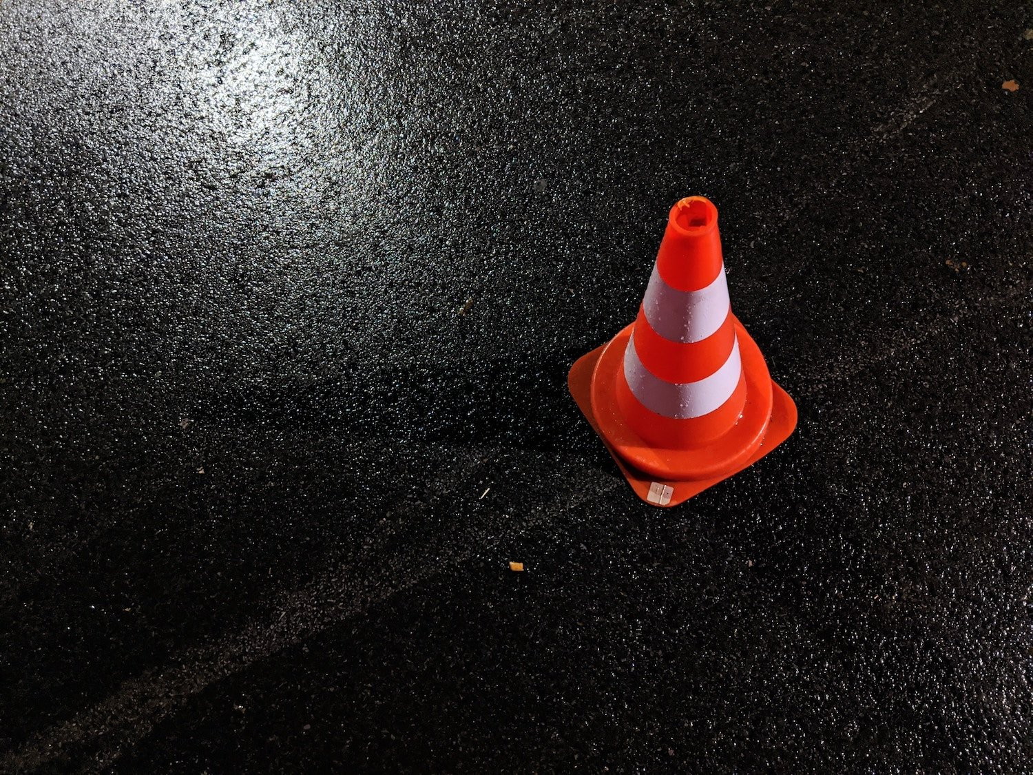 orange cone in parking lot for road test