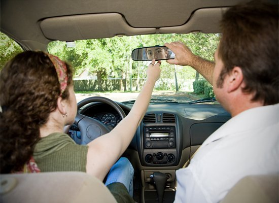 parent teaching teen to drive