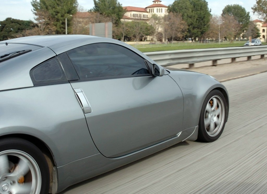 car driving on freeway side view