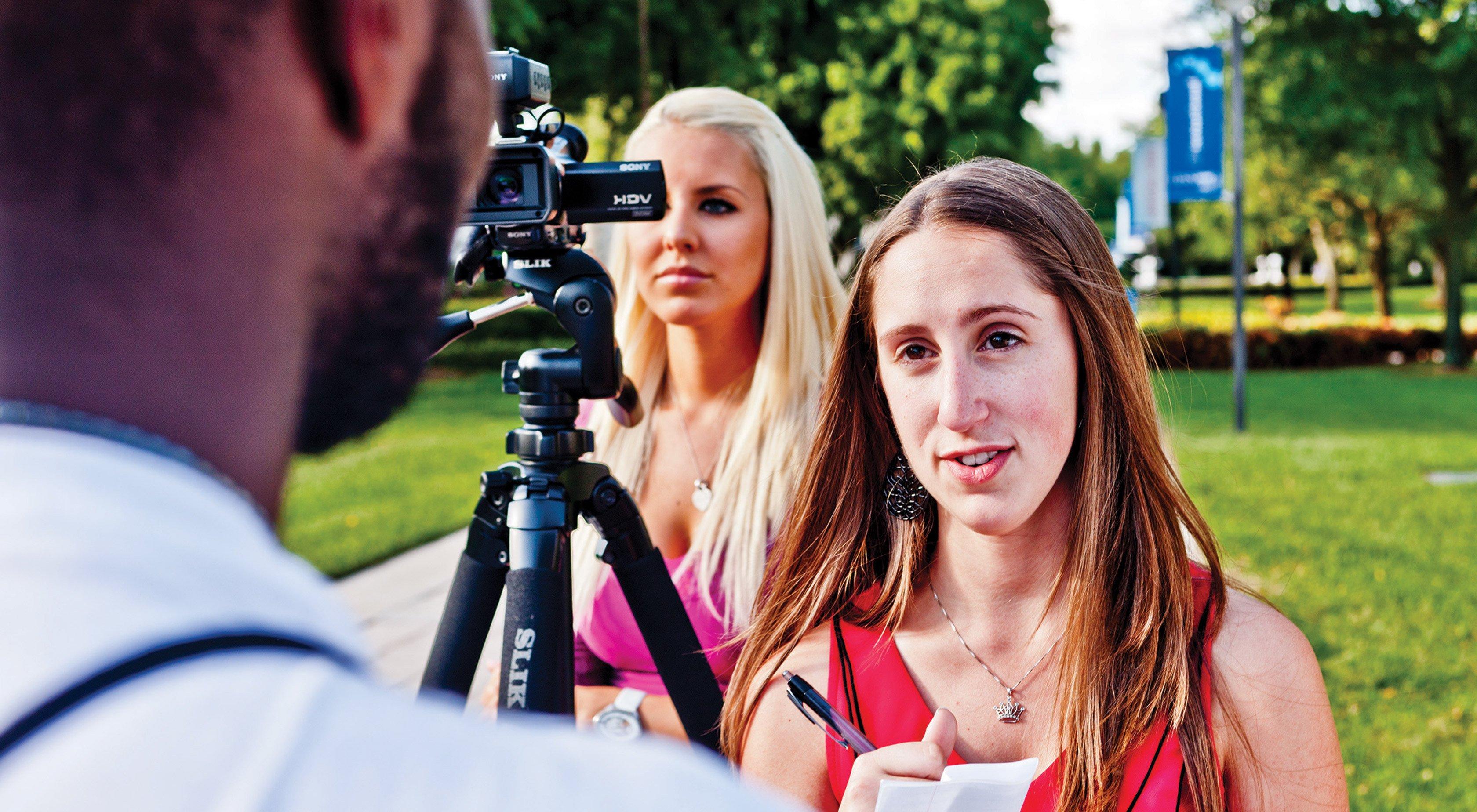 Students studying multimedia journalism at Lynn University.
