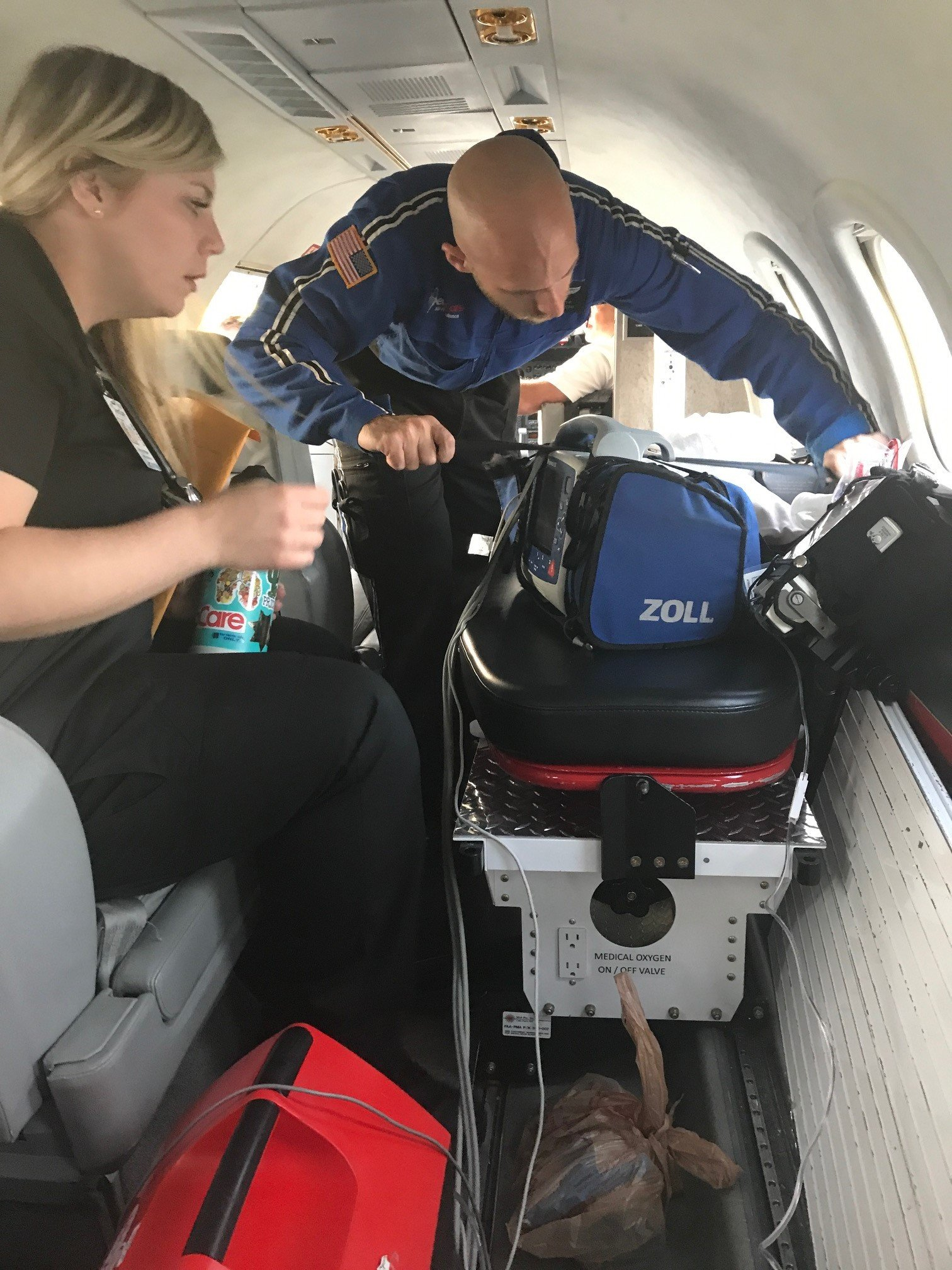 Facing a pulmonary embolism, Bryan is loaded into the ambulance jet.