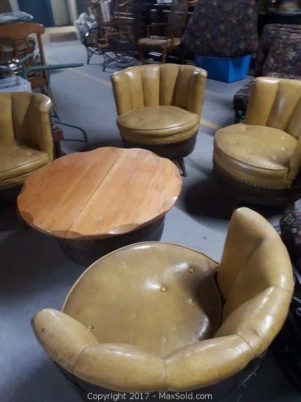 "1960's 4 genuine swivel barrel chairs and coffee table set. Leather (see pictures). Coffee table top opens for storage. chairs 27""""x27"""". Table 30""""x18"""" Very Heavy"