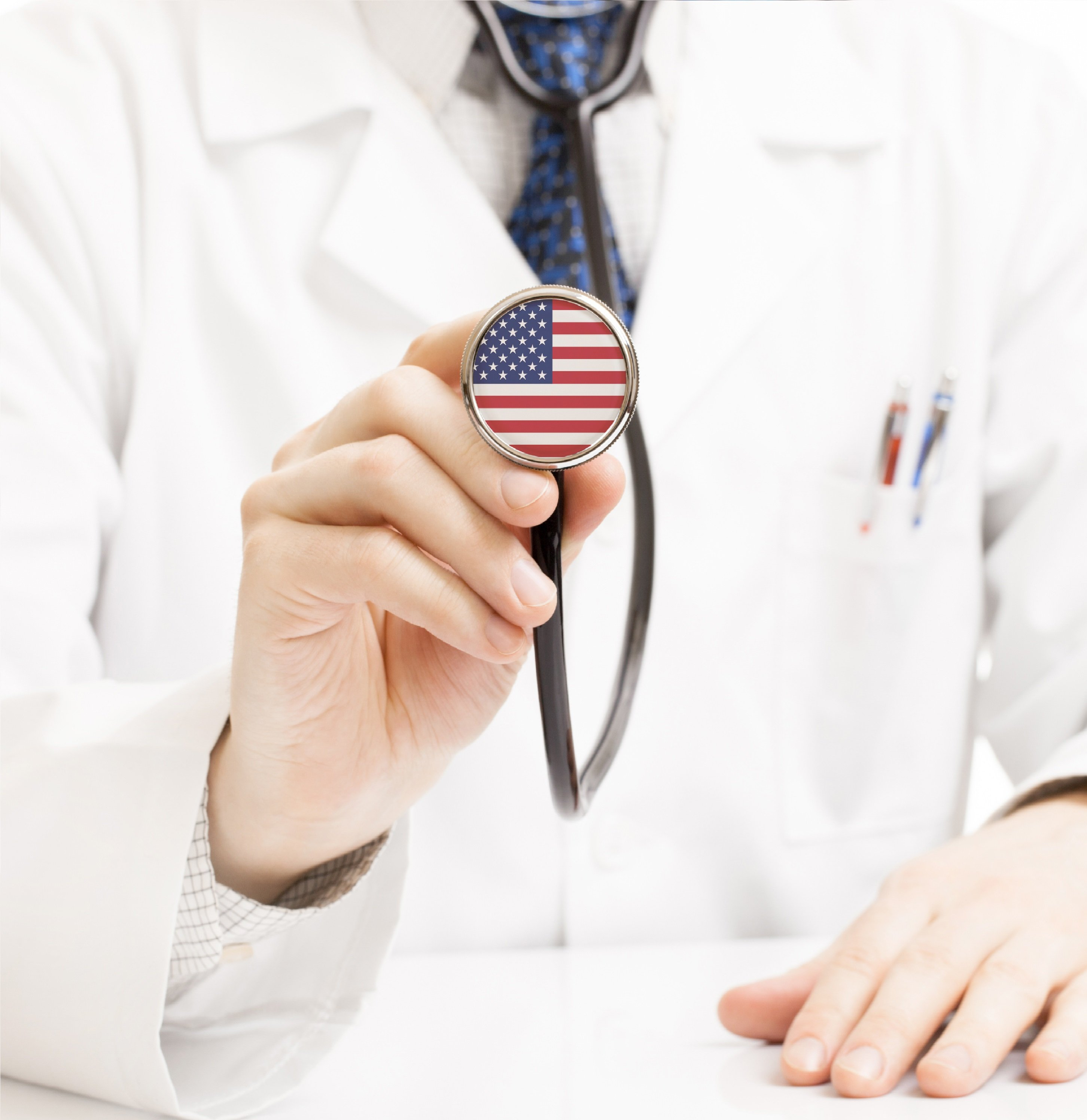 doctor holding an american flag stethascope