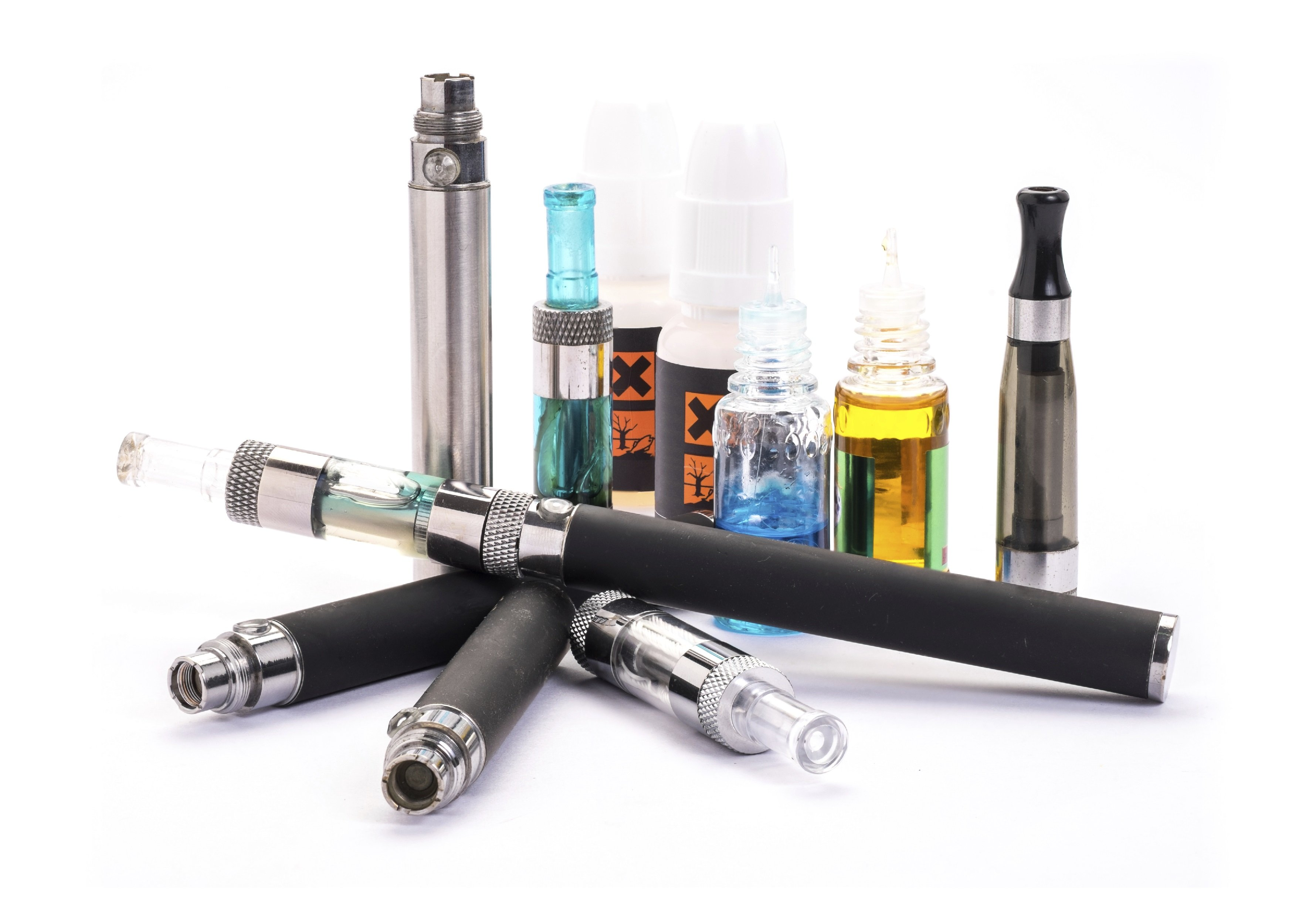 Stack of electronic cigarettes and refill fluid representing their role in smoking and health insurance