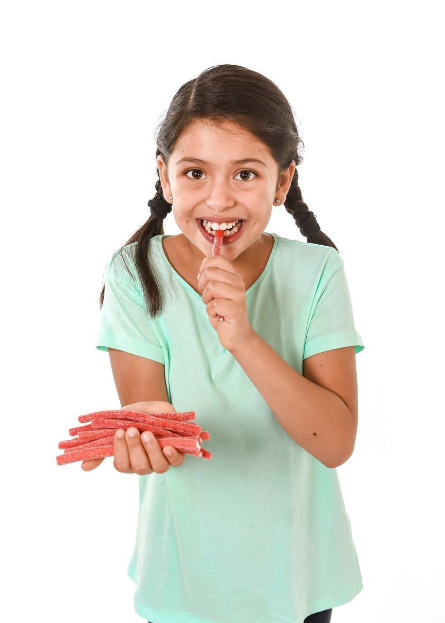 Girl eating red licorice. What is red licorice?