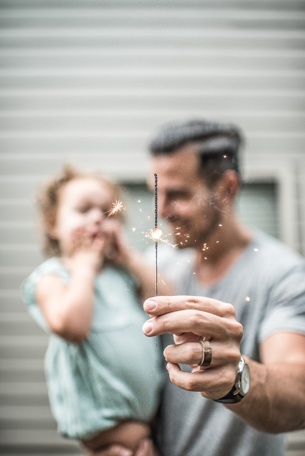 dad-with-girl-and-sparkler