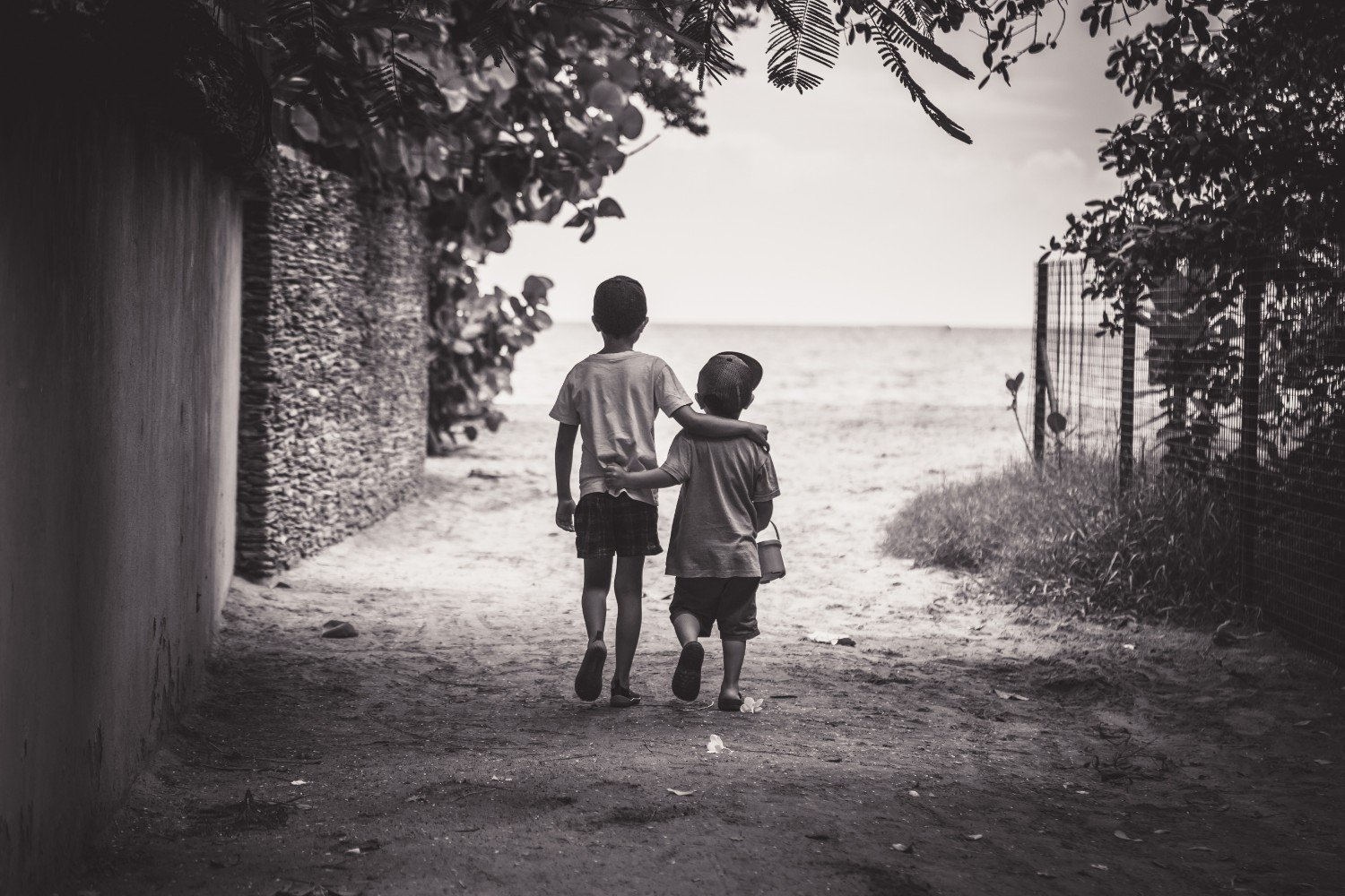 kids-embracing-while-walking
