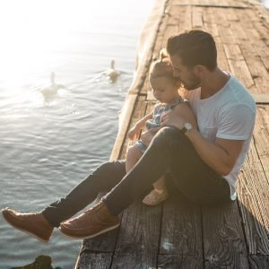 father-with-daughter-on-dock