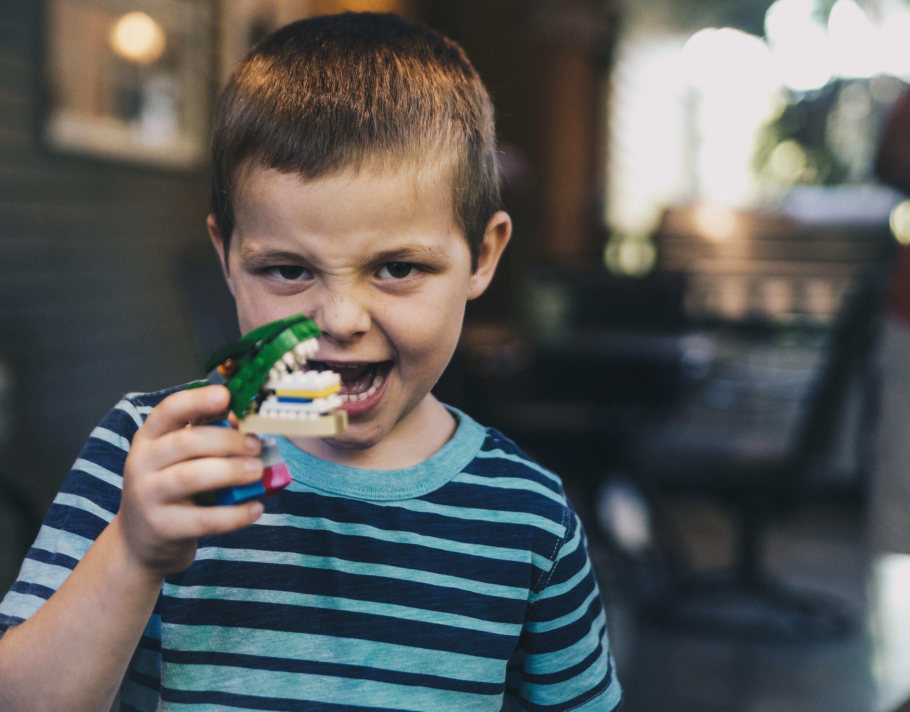boy-holding-monster-making-funny-face