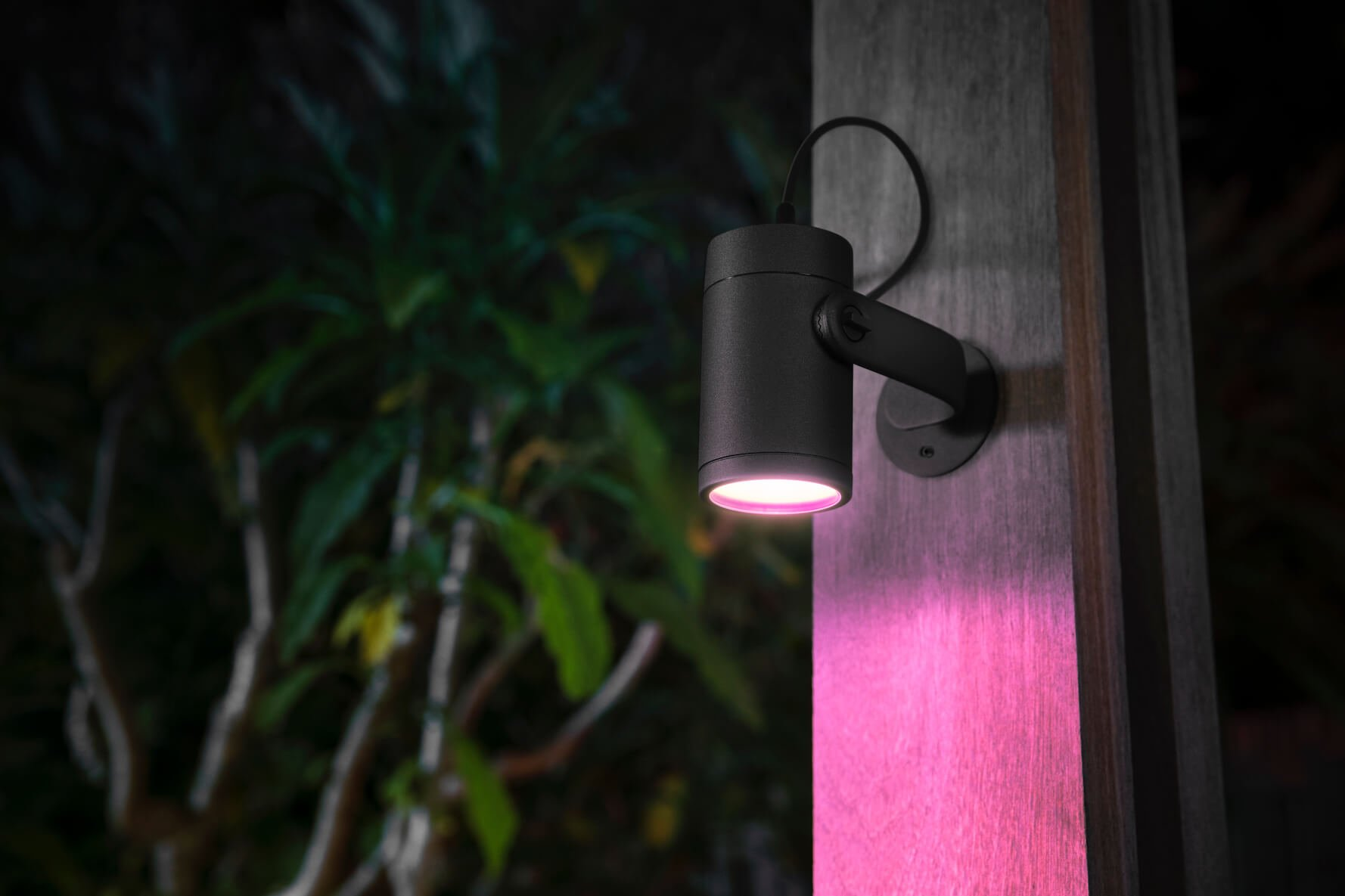 Philips Hue Lily spot light mounted onto a wall